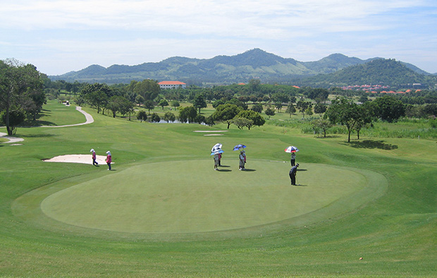 players putting, burapha golf club, pattaya, thailand