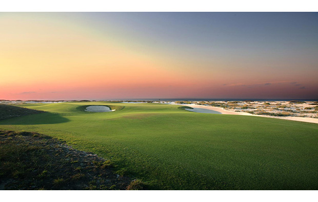sunset over saadiyat island beach golf club, abu dhabi, united arab emirates