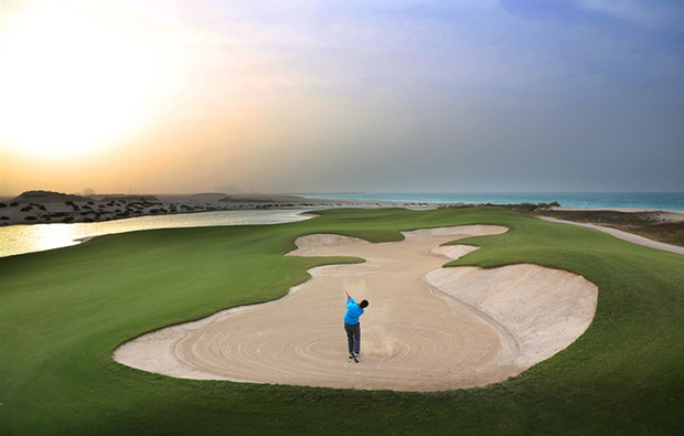 bunker play at saadiyat island beach golf club, abu dhabi, united arab emirates