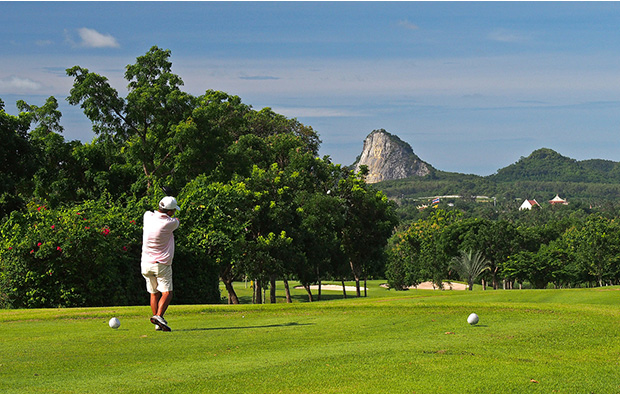 teeing off on  phoenix gold golf country club, pattaya, thailand