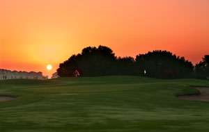sunset over al hamra golf club, dubai, united arab emirates