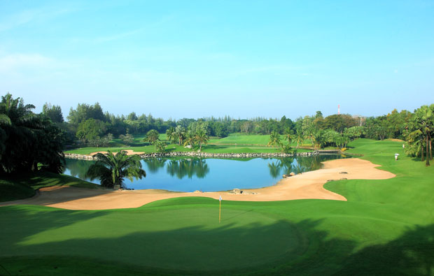 bunkers and water hazzard at alpine golf sports club, bangkok, thailand