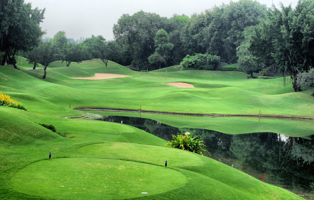 undulating fairways at alpine golf sports club, bangkok, thailand