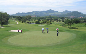 Player putting on green, burapha golf club, pattaya, thailand