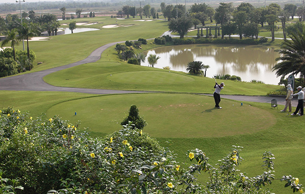 teeing off, long thanh golf resort, ho chi minh, vietnam