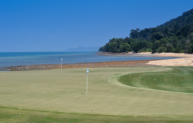 view over green to sea at the els club, langkawi