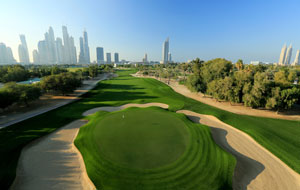 green surrounded by bunker, emirates golf club majlis course, dubai, united arab emirates