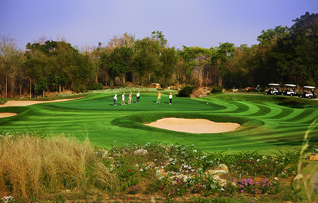 golfers on green, banyan golf club, hua hin, thailand