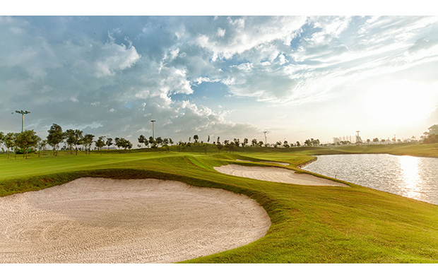 bunkers and water hazard,  long bien golf course, hanoi, vietnam