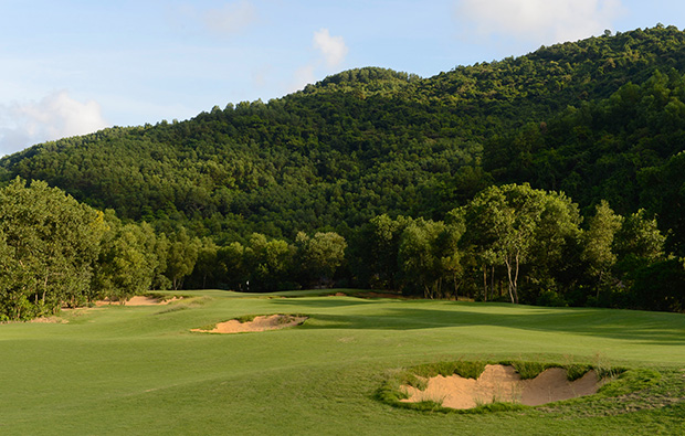 fairway and distant green, laguna lang co golf club, danang, vietnam
