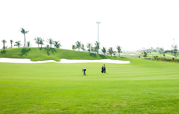 golfers, long bien golf course, hanoi, vietnam