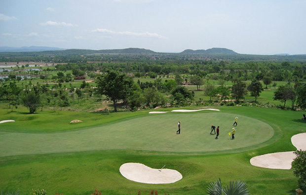 golfers putting, narai hills golf resort, khoa yai, thailand