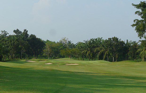 approach to green, greenwood golf club, pattaya, thailand