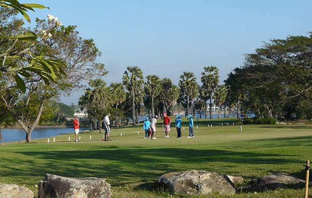 golfers putting, palm hills golf club, hua hin, thailand