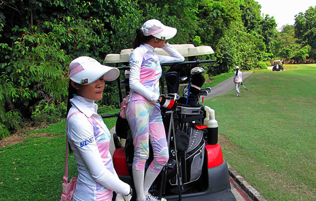 caddies waiting, riverside golf club, jakarta, indonesia