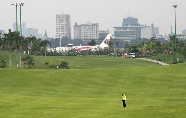 airplane at tan son nhat golf course, ho chi minh,vietnam