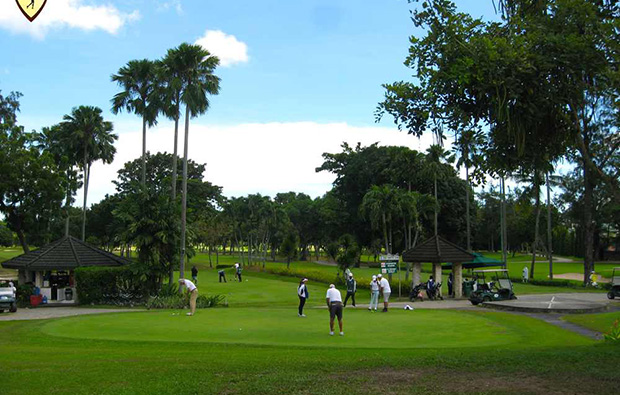 Putting out at Cebu Golf Country Club, Cebu, Philippines