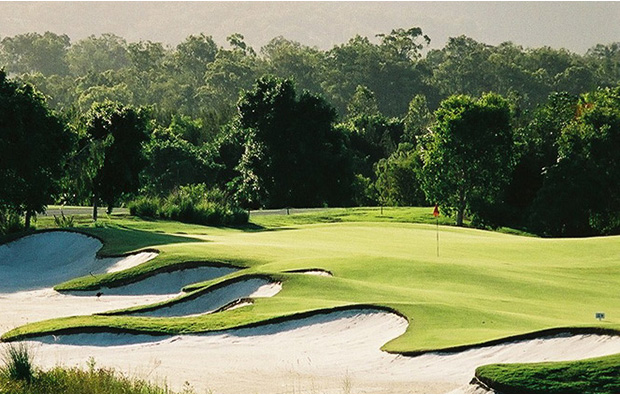 Green surrounded by trees at The Glades Golf Club, Gold Coast, Australia