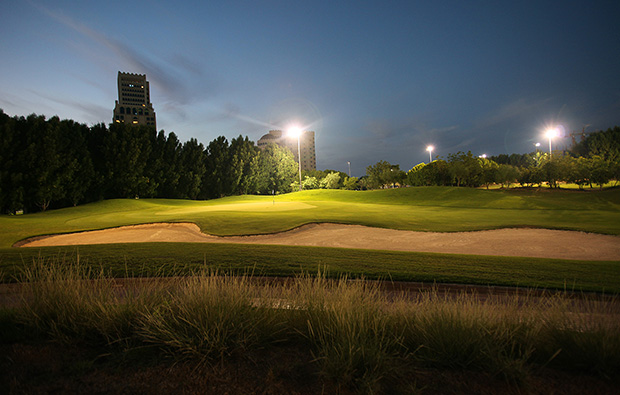 night golf at al hamra golf club, dubai, united arab emirates