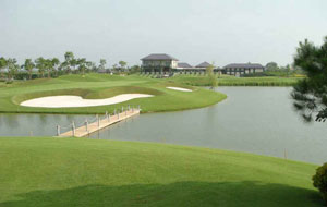 walkway to island green, van tri golf club, hanoi, vietnam
